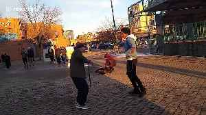 92-year-old grandpa engages in epic dance-off with Chicago street performer [Video]