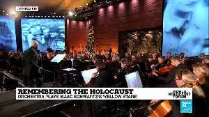 Remembering the Holocaust: Orchestra plays Isaac Schwartz's 'Yellow stars' at Yad Vashem [Video]