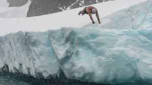 Daredevil Swimmer Becomes First Person To Swim Under Antarctic Ice Sheet Only Wearing Swim Trunks! [Video]