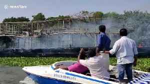 Passengers narrowly escape after sailing boathouse suddenly catches fire in south India [Video]
