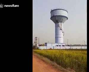Newly-built overhead water tank crumbles and collapses in east India [Video]