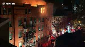 Historic New York City Chinatown building caught on fire while NYPD rescues a trapped resident [Video]
