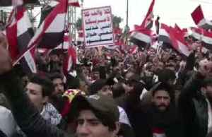 """No to America"": Thousands of Iraqis rally against U.S. military presence [Video]"