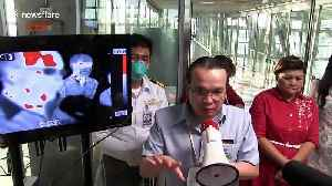 Thai airport screens passengers for coronavirus as country confirms fifth case of the illness [Video]