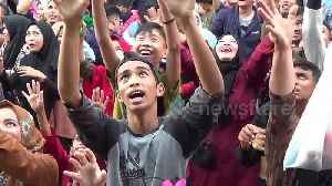 Watch hundreds of Indonesians scramble for sugar in bizarre festival [Video]