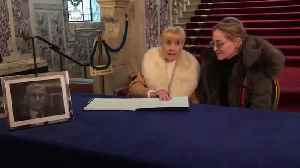 Sharon Stone signs Seamus Mallon book of condolence