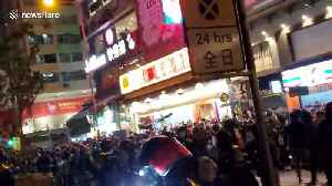 Tension in Hong Kong as riot police make arrests storming street food market [Video]
