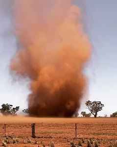 Dust Devil Rips Through Desert [Video]