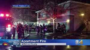 Neighbors Save Person From Burning Apartment [Video]