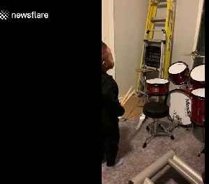 Music obsessed two-year-old has best reaction to brand new drum kit [Video]