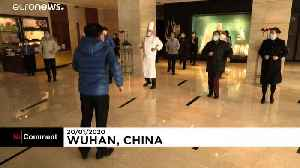 Meet the quarantined hotel staff in Wuhan as they do their daily exercises