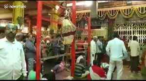 Seemingly 'possessed' women perform bizarre feats at Indian temple of exorcism [Video]