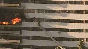 Video Shows Man Clinging to Outside of California Apartments as Fire Ripped Through High-Rise [Video]