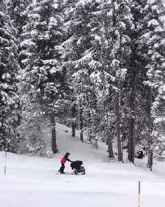 Man Melds Skiing and Babysitting [Video]