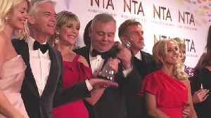 Eamonn Holmes appears to grab NTA trophy from Phillip Schofield [Video]