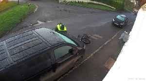 Cyclist Slips on Ice and Slams Car [Video]