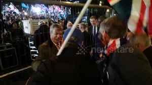 Beaming Nigel Farage greets fans as UK leaves the EU [Video]