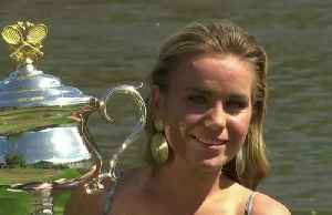 Sofia Kenin poses with Australian Open trophy [Video]
