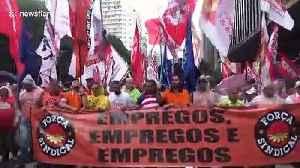 Union workers in Brazil rally against President Bolsonaro's cutbacks [Video]