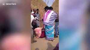 School teacher bound and beaten by political party representatives for protesting government land seizure in east India [Video]