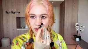 Watch Grimes Do Her Pregnancy Skincare and Psychedelic Makeup Routine [Video]