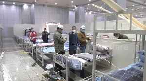 Makeshift hospitals built in Wuhan amid overflow of coronavirus patients [Video]