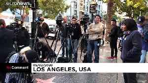 Flowers and wreaths laid on the Hollywood walk of fame star of Kirk Douglas [Video]