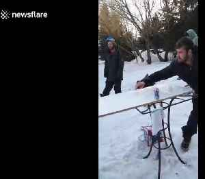 Good catch! Man throws a glass of beer using a snowboard and his friend successfully catches it [Video]