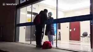 Chinese nurse working in coronavirus isolation ward kisses boyfriend through glass door [Video]