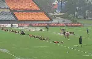 Rugby players slip and slide as heavy rain hits Australia [Video]