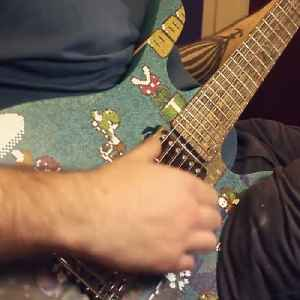 Guy makes Mario guitar out of popsicle sticks [Video]