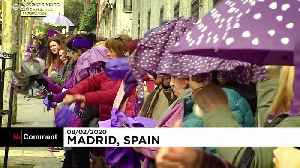 Thousands of women dye Madrid purple with human chain against violence [Video]