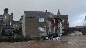 Wall of guest house collapses into river as storm batters the Borders [Video]