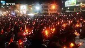 Thousands of grieving Thais hold candlelight vigil for mass shooting victims [Video]