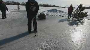 Finding Minnesota: Arctic Golf Tournament Takes Place On Frozen Lake [Video]