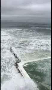 Waves crash into Bondi Beach's famous Iceberg Club as storm hits Sydney [Video]