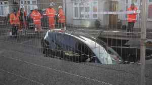 Motorist had a miracle escape after driving car into a SINKHOLE [Video]