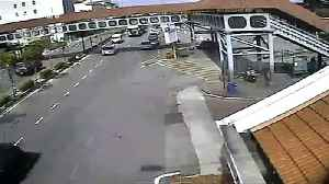 Truck driver misjudges height of load and hits footbridge in Malaysia [Video]