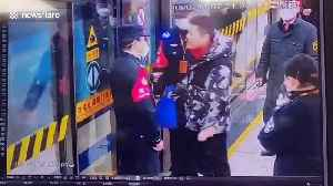 Chinese man attacks police officers who stop him from boarding train without wearing mask during coronavirus outbreak [Video]