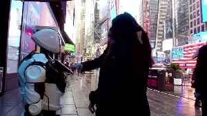 Coronavirus-warning robot descends on Times Square [Video]