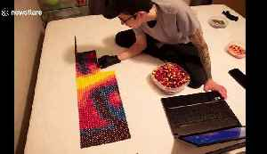 Ever wondered what Billie Eilish made from over 7,000 Skittles looks like? [Video]