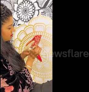 News video: World record-holding henna artist decorates heels in beautiful design