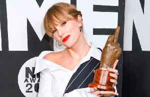 Taylor Swift makes surprise appearance to accept NME Award [Video]