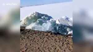 Huge chunks of ice from melting lake wash up on northern China beach [Video]