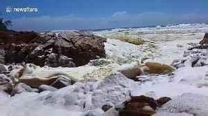 Australian beach with 'unusually high tide' and sea foam closed ahead of Cyclone Uesi [Video]