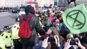 Violent scenes as youth climate protesters clash with police in central London [Video]