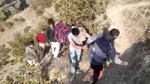 Indian villagers make 10km mountain trek carrying sick man to hospital due to stalled road building [Video]