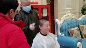 Coronavirus medics shave heads [Video]
