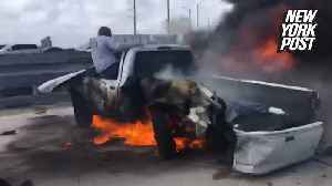 Man rescued from burning car while 20 people film it [Video]