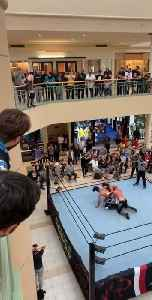 Wrestler Jumps From First Floor of Mall into Ring On Top of Opponent Wrestlers [Video]